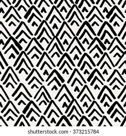 Hand drawn seamless repeating pattern with diamond shapes in black and cream.