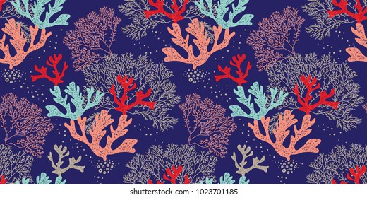 Hand drawn seamless vector pattern. Trendy pattern with corals and algae on a blue background for printing, fabric, textile, manufacturing, wallpapers. Sea bottom.