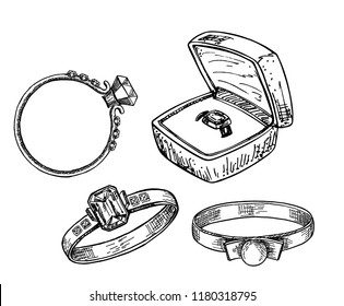 Hand drawn a set of different jewelry rings. Vector illustration of a sketch style. Ring in the gift box.