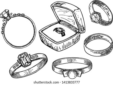 Hand drawn a set of different jewelry rings. Engagement rings and wedding rings. Vector illustration of a sketch style. Ring in the gift box.