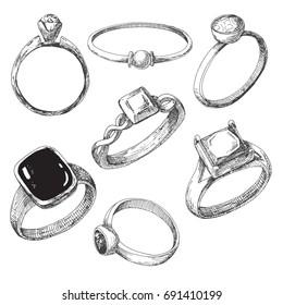 Hand drawn a set of different jewelry rings. Vector illustration of a sketch style.