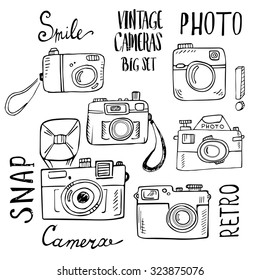 Hand drawn set of retro cameras with lettering. Vector illustration isolated on white background.