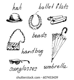 Hand drawn set of woman accessories. Vector sketch illustration.