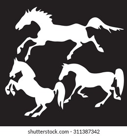 Hand drawn sketch set of horses silhouettes on black background.
