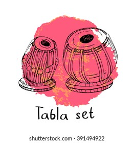 Hand drawn sketch of a traditional Indian percussion instrument tabla on a big stain in pink and orange colors. EPS 10.