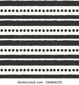 Hand drawn style ethnic seamless pattern. Abstract geometric tiling background in black and off-white.