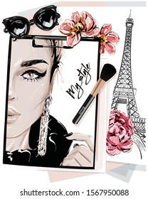 Hand drawn stylish table set with notes, sketches, makeup brush, sunglasses and flowers. Woman face sketch and eiffel tower. Vector illustartion.
