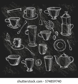 Hand drawn tea collection on a blackboard-cups of a different form,  lemon,  teapot, the French press for coffee.Hand drawn doodle sketch.Vector.