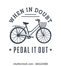 Hand drawn textured vintage label with bicycle vector illustration and inspirational lettering. When in doubt, pedal it out.