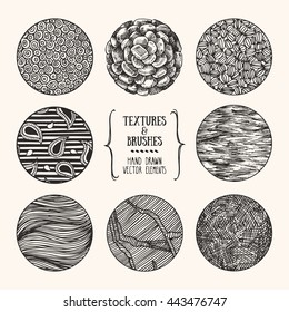 Hand drawn textures and brushes. Artistic collection of design elements: bubbles, stones, bricks, wavy lines, natural backgrounds, paisley pattern made with ink. Isolated vector.