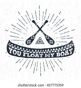 """Hand drawn tribal badge with textured canoe vector illustration and """"You float my boat"""" inspirational lettering."""