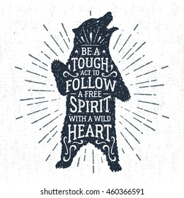 "Hand drawn tribal badge with textured grizzly bear vector illustration and ""Be a tough act to follow, a true spirit with a wild heart"" lettering."