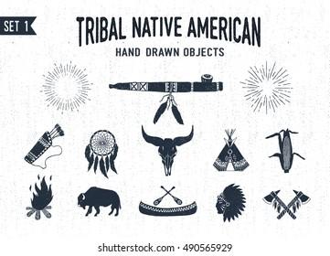 Hand drawn tribal icons set with peace pipe, dream catcher, buffalo skull, teepee, corn, bonfire, buffalo, canoe, chief, and tomahawks vector illustrations.