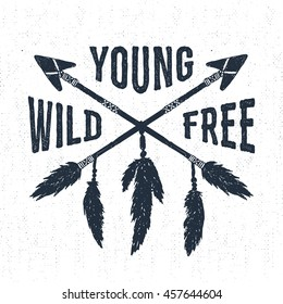 "Hand drawn tribal label with crossed arrows vector illustration and ""Young, wild, free"" inspirational lettering."