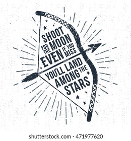"Hand drawn tribal label with textured bow vector illustration and ""Shoot for the moon. Even if you miss, you'll land among the stars"" inspirational lettering."