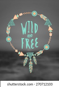 """Hand drawn typographic design """"Wild and Free"""" and dreamcatcher in pastel colors on a blurred black and white sea background. EPS 10 file, gradient mesh and transparency effects used."""