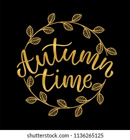 "Hand drawn typography gold lettering:"" Autumn time"" isolated on the black background with golden wreath."