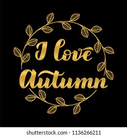 "Hand drawn typography gold lettering: ""Ilove Autumn"" isolated on the black background with golden wreath."