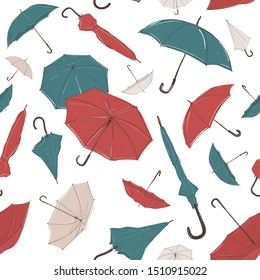 Hand drawn umbrella of different size and from different angles in sketch style. Seamless background with small and big, red, green and white umbrellas of different foreshortening, in careless lines.