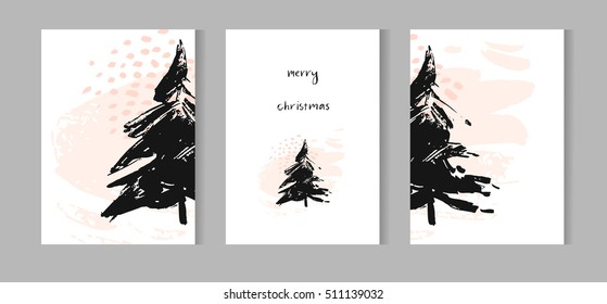 Hand drawn vector abstract Christmas decoration cards set design with dirty brush painted Christmas trees and handwritten modern lettering phase Merry Christmas isolated on white background.