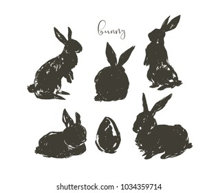Hand drawn vector abstract ink sketch graphic drawing scandinavian Happy Easter simple bunny illustrations sihouette collection set with freehand collage textures isolated on white background.