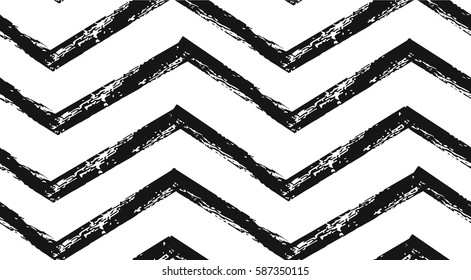 Hand drawn vector abstract rough geometric monochrome seamless zig zag chevron pattern in black and white colors.Hand made grunge brush painted texture.Scandinavian concept design for fashion,fabric
