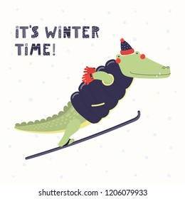 Hand drawn vector illustration of a cute funny crocodile ski jumping outdoors in winter, with text Its winter time. Isolated objects on white. Scandinavian style flat design. Concept children print.