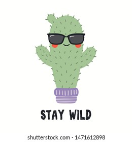 Hand drawn vector illustration of a cute funny cactus in sunglasses, with quote Stay Wild. Isolated objects on white background. Flat style design. Color drawing. Concept for summer children print.