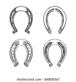 Hand drawn vector illustration - Set of horseshoes. Vintage