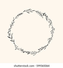 Hand drawn vector round frame. Floral wreath with leaves, berries, branches. Ink, vintage and rustic styles.