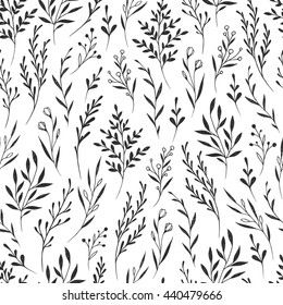 Hand drawn vector seamless pattern with floral elements. Vector pattern with leaves, twigs, branches, berries, grass. Black and white.