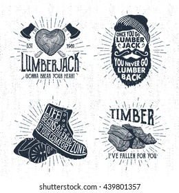 Hand drawn vintage badges set with textured tree trunk, crossed axes, bearded face, boots, and timber vector illustrations and inspirational lettering.