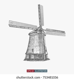 Hand drawn vintage windmill. Engraved style vector illustration. Element for your design works.