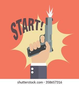 Hand firing a gun with start word. Business startup concept