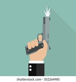 Hand firing a gun for starting race. Business startup concept