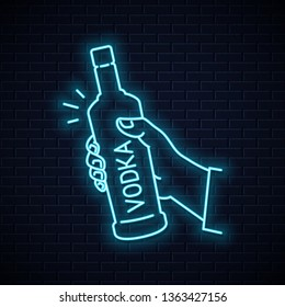 Hand hold vodka bottle neon sign. Male hand holding a vodka on wall background