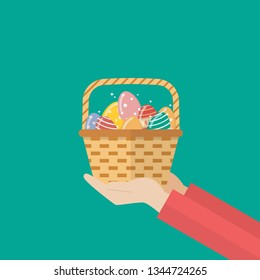 Hand holding basket with easter eggs. Easter holiday Vector illustration