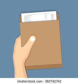 Hand holding brown envelope