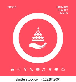 Hand holding a cake icon. Graphic elements for your design