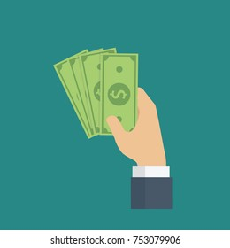 Hand holding cash with pay or buying gesture