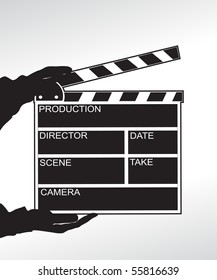 Hand holding a clapper board