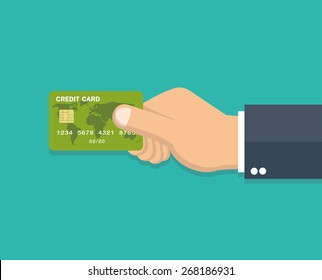 Hand holding credit card - Flat style