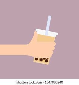 Hand holding a cup of Milk Bubble Tea. Vector icon