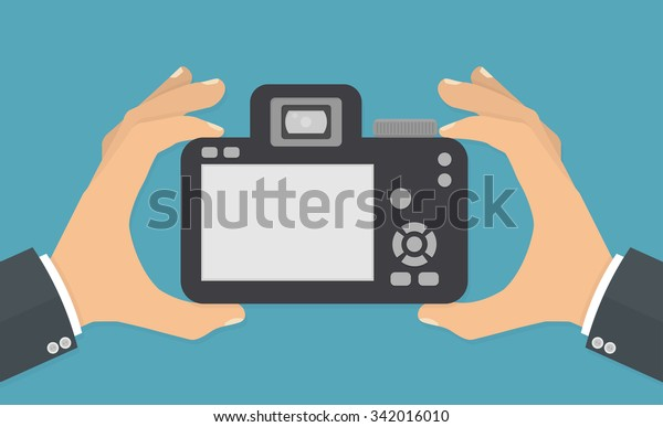 Hand holding digital camera with blank screen. Flat style