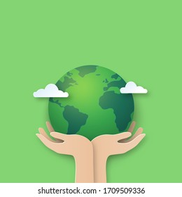 Hand holding earth.Paper cut of world environment day background.
