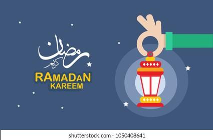 "hand holding ""fanous"" means lantern ..Ramadan Kareem greeting card"