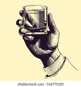 Hand holding glass with strong drink. Vintage hand drawing vector illustration. Drink tequila or whiskey, beverage booze in hand
