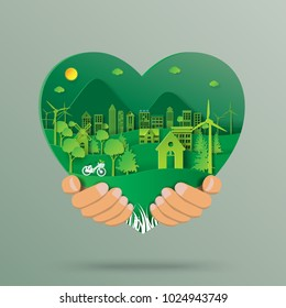 Hand holding green heart with urban forest and eco city abstract paper art background.Ecology and environment conservation with love nature concept.Vector illustration.