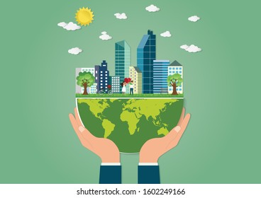 Hand holding green world with Love couple holding heart shape stand in the meadows and a bicycle with the city background, We love the world and Eco friendly concept