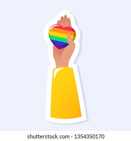 Hand Holding A Heart. LGBTQ+ related symbol in rainbow colors. Gay Pride. Raibow Community Pride Month. Love, Freedom, Support, Peace Symbol. Flat Vector Design Isolated on White Background